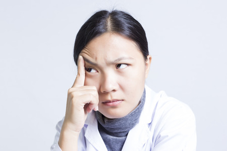 女性 Sciencetist の感情: Ach を頭 写真素材
