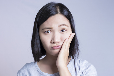 toothache: Woman is Having Toothache Stock Photo
