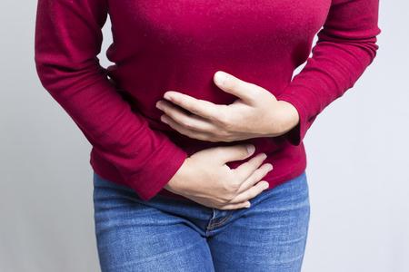 女性の腹痛 写真素材