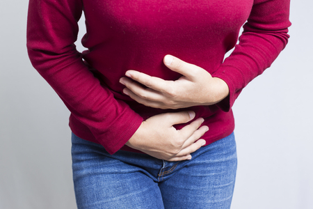 hands on stomach: Woman Stomach Ache