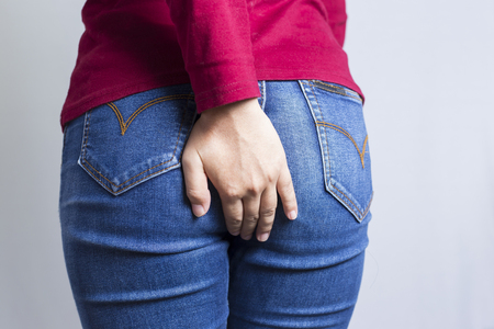 Woman has Diarrhea Holding his Butt: Isolated on White Background