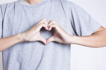 show of hands: Man show heart hands Stock Photo