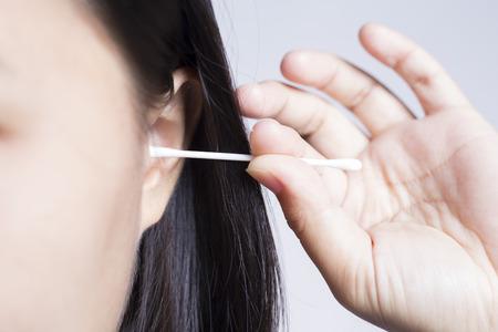 ear buds: Woman Picking Her Ear