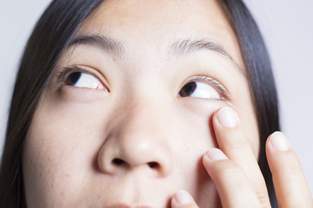 drowsiness: Woman Rubbing Her Eye