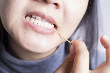 toothpick: Toothpick her Teeth