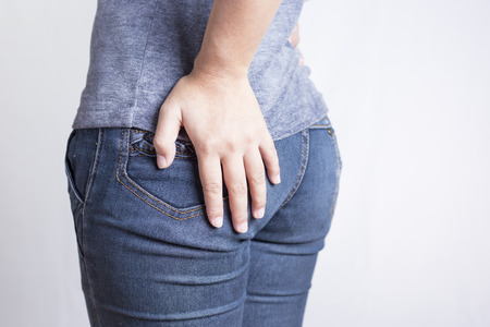 anus: Woman has Diarrhea Holding his Butt: Isolated on White Background