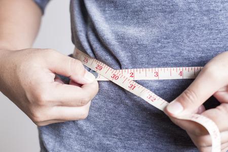 waistline: Woman Checking Waistline Stock Photo
