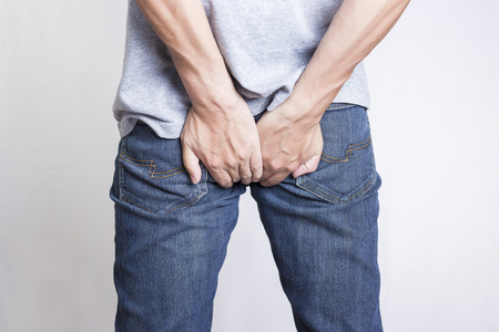 Man has Diarrhea Holding his Butt: Isolated on White Background