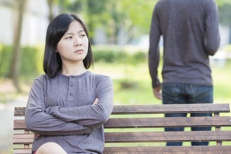 quarrel: Couple in Quarrel at Park Stock Photo