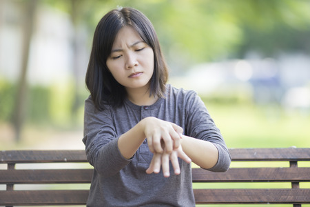 scratching: Woman Scratching Her Hand