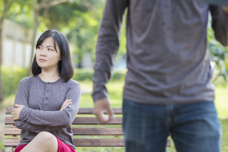 argument from love: Couple in Quarrel at Park Stock Photo