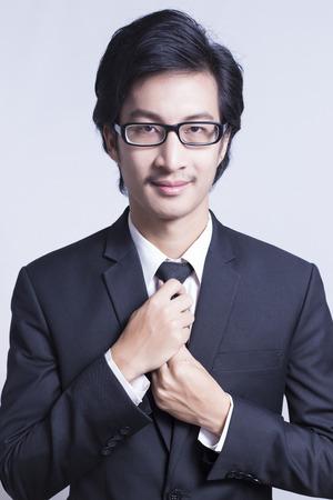 necktie: Businessman Adjust Necktie his Suit Stock Photo