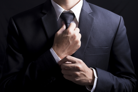 Businessman Adjust Necktie his Suit Banque d'images