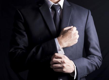 Businessman Fixing Cufflinks his Suit Archivio Fotografico