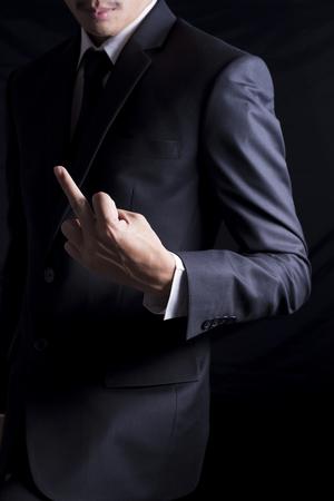 obscene: Businessman Show Middle Finger Stock Photo