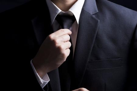 Businessman Adjust Necktie his Suit Stock Photo