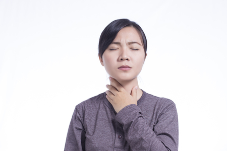 Woman Has Sore Throat on Isolated White Background