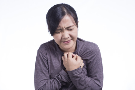 Woman Has Chest Pain on Isolated White Background