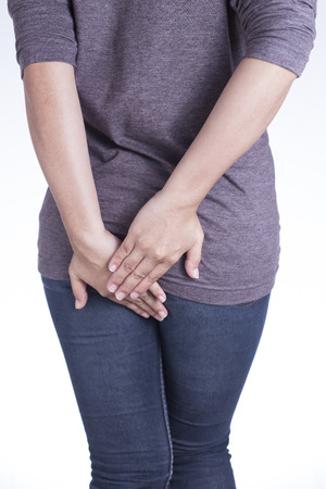 anus: Woman Has Diarrhea Holding Her Butt on Isolated White Background Stock Photo