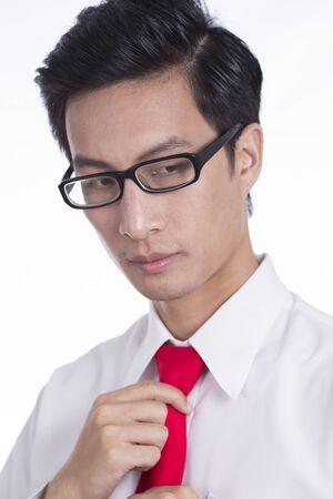 adjusting: Businessman Adjusting His Necktie