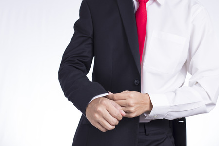 adjusting: Businessman Adjusting Cufflinks his Suit Stock Photo