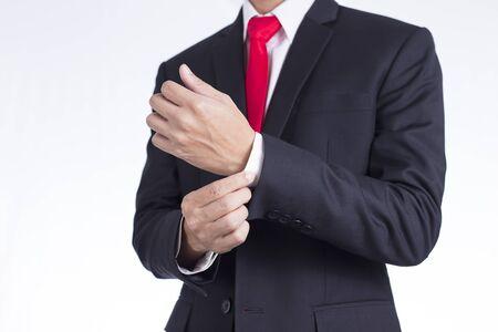 Businessman Adjusting Cufflinks his Suit Stock Photo