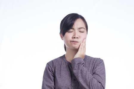 tooth ache: Woman Has Tooth Ache on Isolated White Background