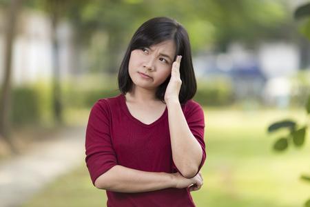 head ache: Woman Has Head Ache at Park Stock Photo