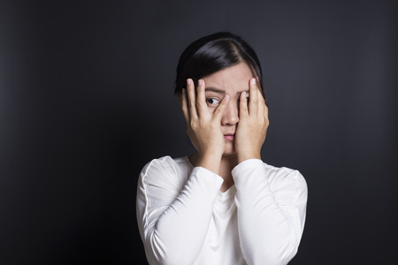 woman hiding: Woman hiding face laughing timid Stock Photo