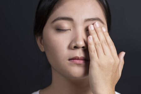 sore eye: Woman has a pain in eye