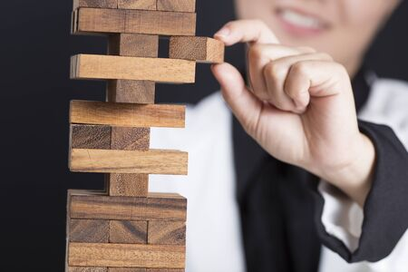 fragile economy: Business woman Builds a Tower Stock Photo