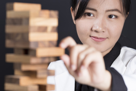builds: Business woman Builds a Tower Stock Photo