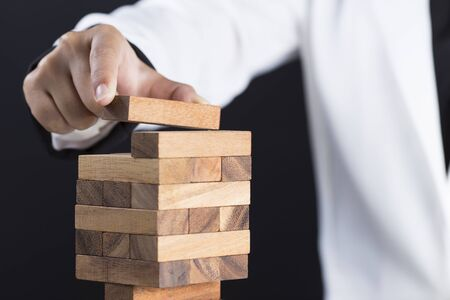 build: Business woman Builds a Tower Stock Photo