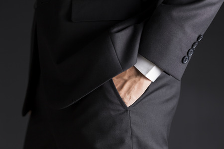 put on: Businessman Put His Hand in His Pocket