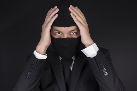 deceitful: Businessman Wearing a Balaclava Thinking Corruption Plan but He Failure