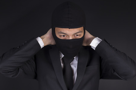 miscarry: Businessman Wearing a Balaclava Thinking Corruption Plan but He Failure