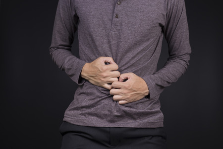 constipation symptom: Man Stomach Ache