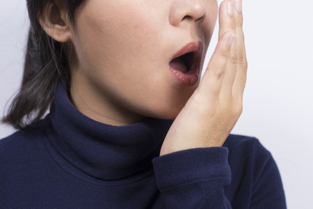 bad skin: Health Care: Woman checking her breath with her hand