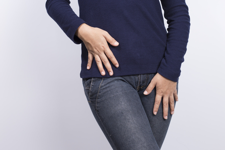 crotch: Woman with Hands Holding her Crotch