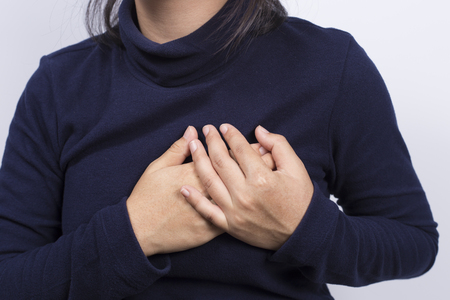 chest pain: Health Care: Woman has chest pain