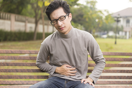 constipation symptom: Man has stomach ache