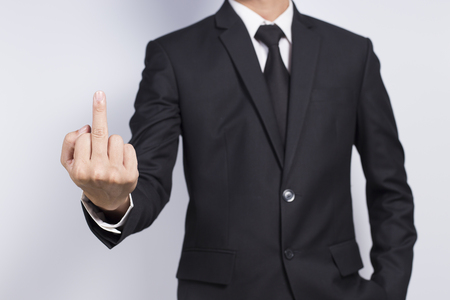 aggression: Businessman Show Middle Finger Stock Photo