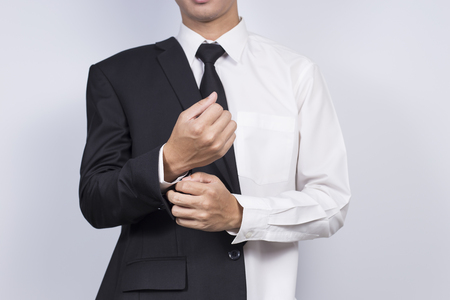 suit  cuff: Businessman Adjusting Cufflinks his Suit Stock Photo