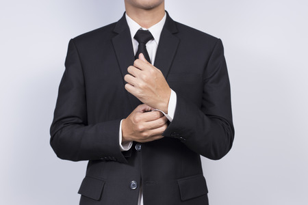 cufflink: Businessman Adjusting Cufflinks his Suit Stock Photo