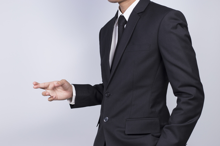 unethical: Businessman crossing his fingers Stock Photo