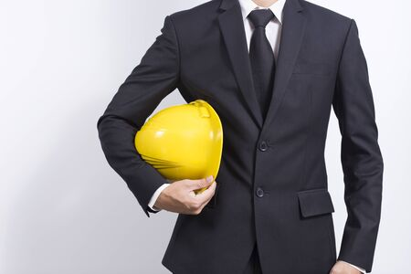 indenture: Engineer in black suit on isolated white background Stock Photo