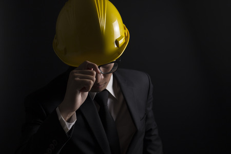 indenture: Engineer in black suit on isolated black background