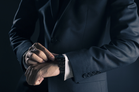 suit  cuff: Businessman checking time from watch
