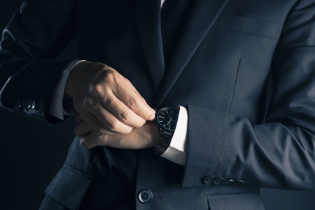 checking time: Businessman checking time from watch