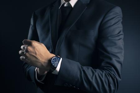 Businessman Fixing Cufflinks his Suit Banco de Imagens